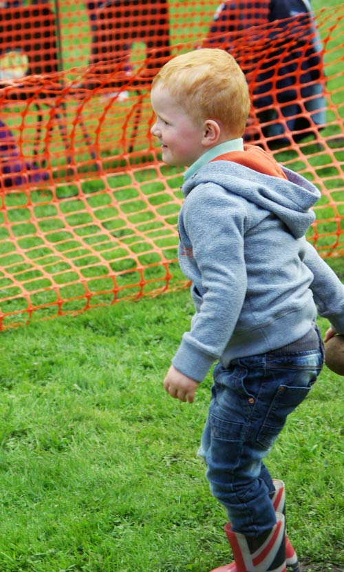 Young visitor at the coconut shy Fair and Show 2015