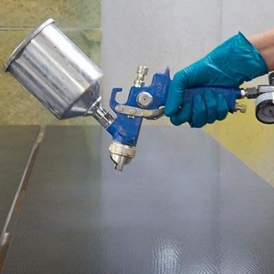 EM1000 Universal Sanding Sealer being applied over EM6600 Raven Black Lacquer