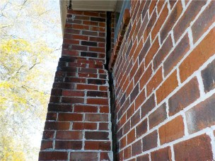 Chimney separating from home showing foundation issues