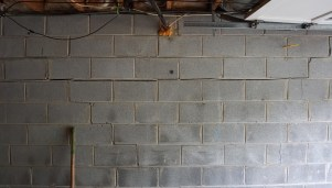 Concrete block basement wall with crack