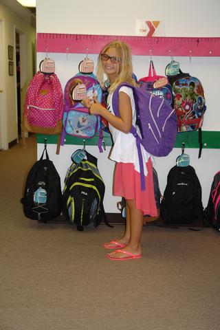 little girl with one of the donated backpacks