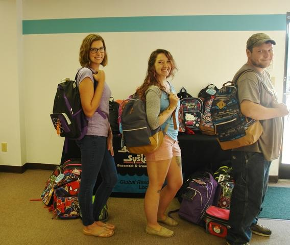 Team Tar Heel wearing the donated backpacks