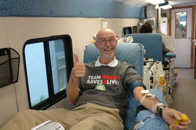 Owner, Pete Burgess gives blood