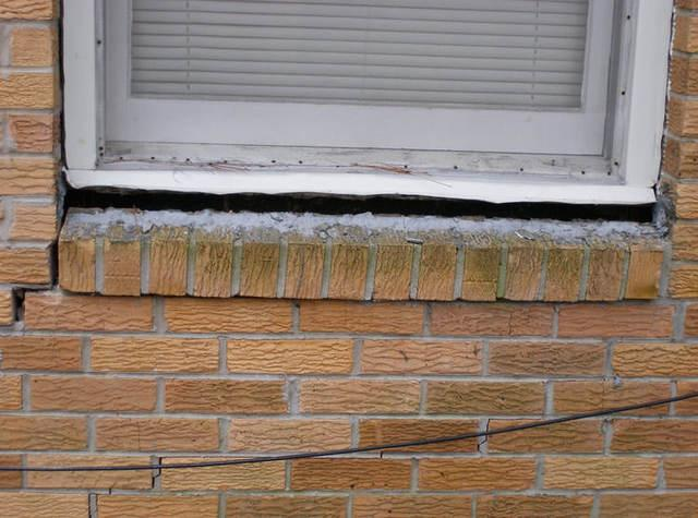 cracks around window on the outside of the home