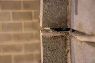 Closeup of bowing wall with gap