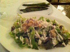 The sides for Steve's Surf & Turf: Caesar Salad and Asparagus.