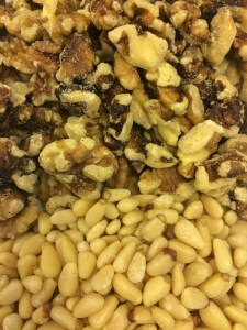 Walnuts and Pine Nuts. You can substitute slivered almonds for the pine nuts. However, the walnuts are a must.