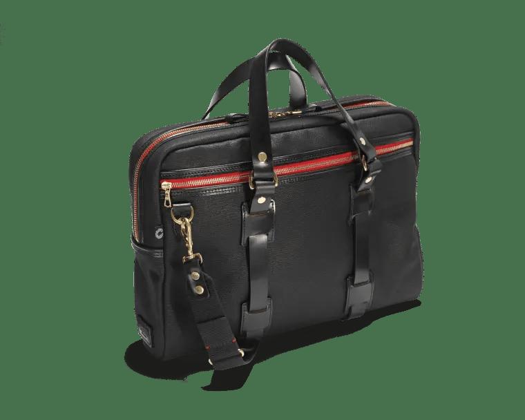 Die schwarze Vintage Laptop Tasche im Vordergrund