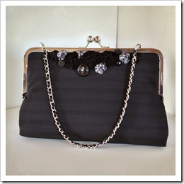 Black and gray yoyo purse with ribbon chain