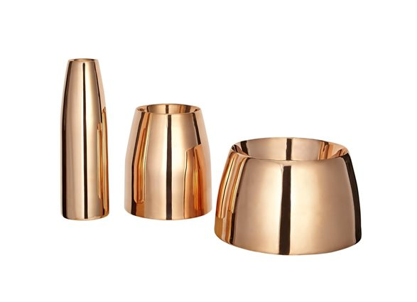 a trio of copper vases
