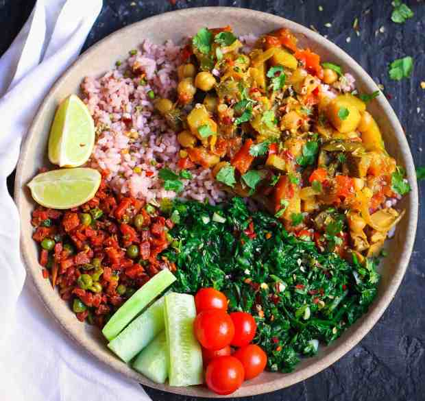 Moroccan Vegetable Stew Served with Red Rice, Sauteed Spinach, Stirfried Carrots & Peas, vegan healthy