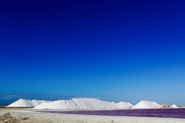 Bonaire Travel Guide: Salt piles at the Cargill salt mine