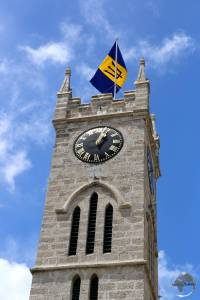 Coral-limestone clock tower in Bridgetown with the Barbados flag