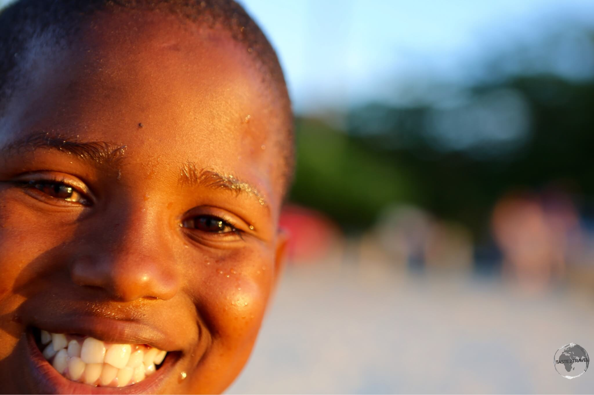 A happy local boy at sunset on Grand Anse beach.