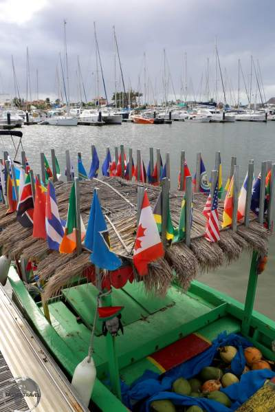 A boat at Rodney Bay marina, flying all the flags of the Caribbean and North America.