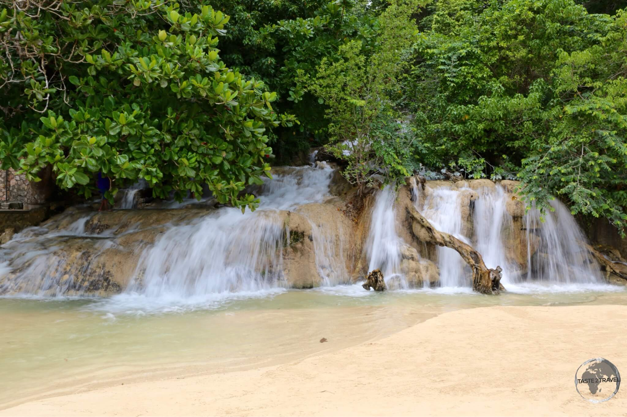 Dunn's River falls cascading onto the beach near Ocho Rios.
