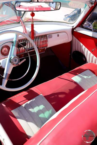 The interior of an American classic car in Havana old town.