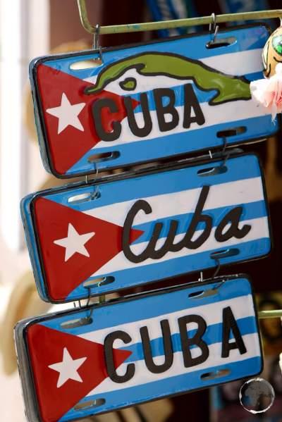 Souvenir Cuba flag license plates on sale in Havana old town.