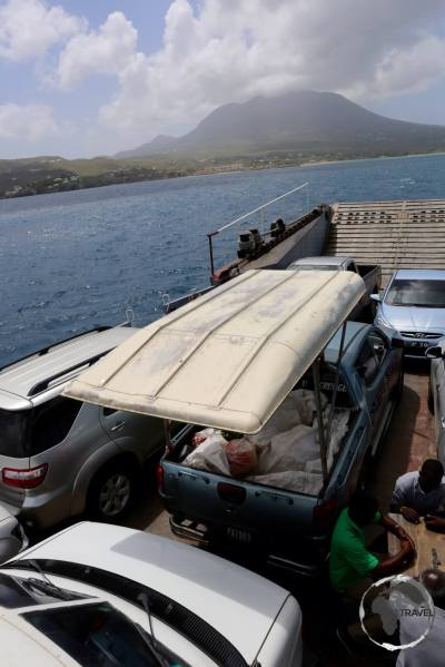 The sea-bridge ferry from St. Kitts to Nevis with Nevis Peak in the background.