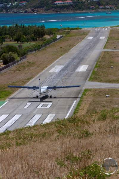 A Winair flight from St. Martin, landing on the very short runway at St. Barts.