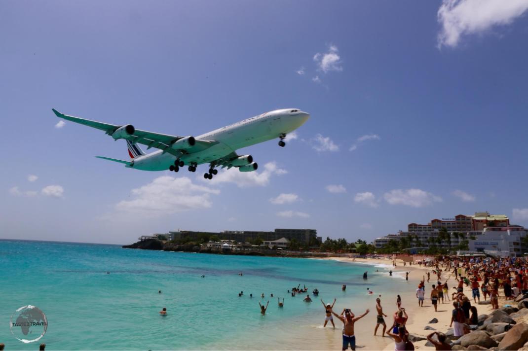 Saint Martin/ Sint Maarten Travel Guide: Air France flight over Maho Beach