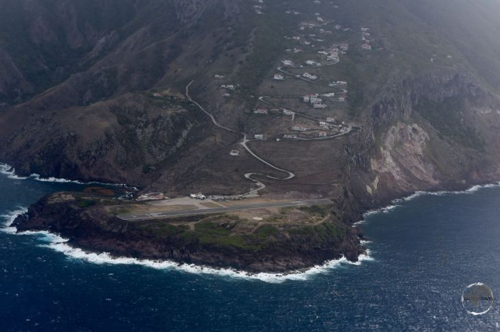 Saba Travel Guide: This view of Saba airport, shortly after take-off, shows the perilous position of the short runway.