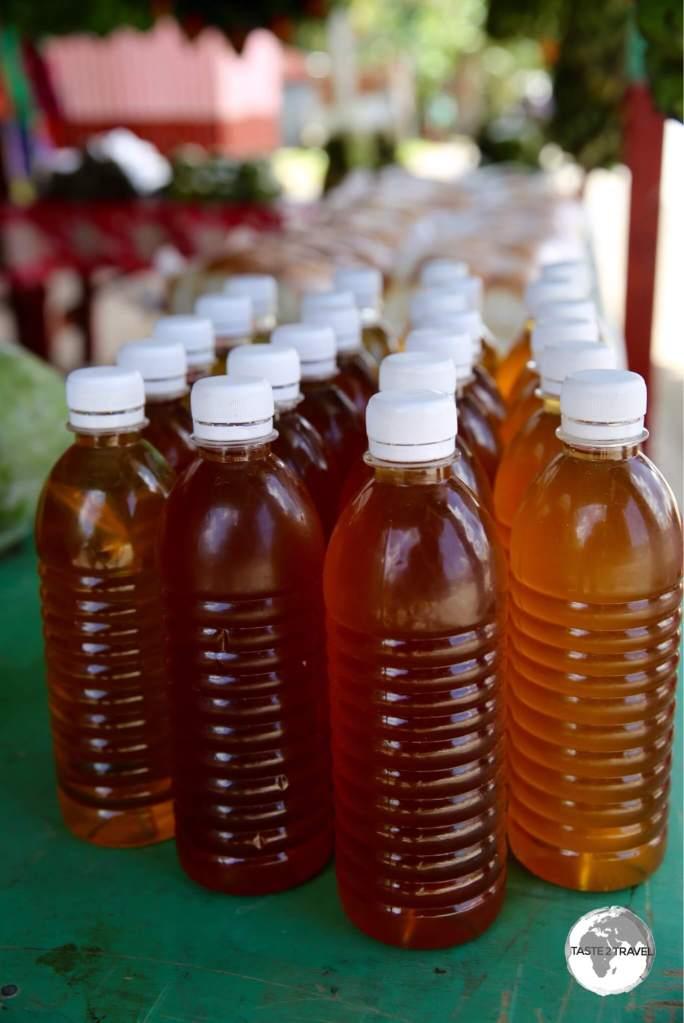 Homemade coconut oil for US$2 per bottle.