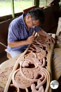 Traditional Storyboard wood carver in Koror.