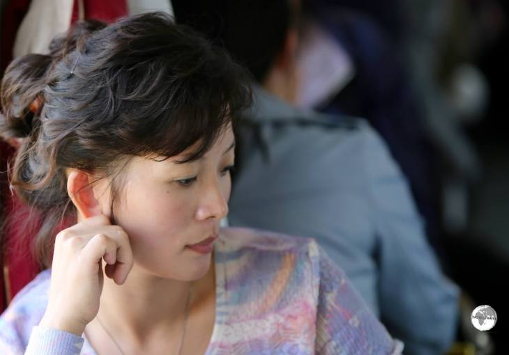 Deep in thought - a North Korean passenger on the train from Sinuiju to Pyongyang,