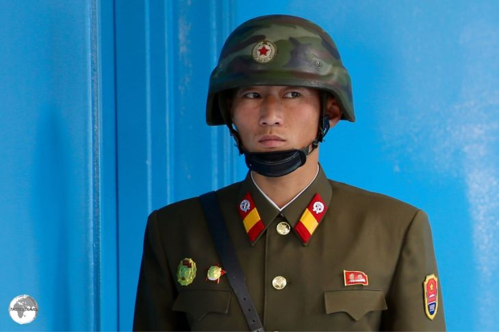 North Korean soldier at the DMZ guarding the door which opens into South Korea.