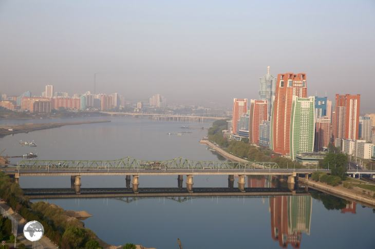 Morning view of the Taedong river and Future Scientist street from the Yanggakdo International Hotel