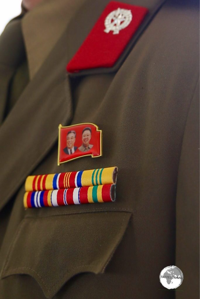Once North Koreans 'come of age', they don the party badge – this is worn everyday, everywhere. Some badges feature both leaders while others feature just one.