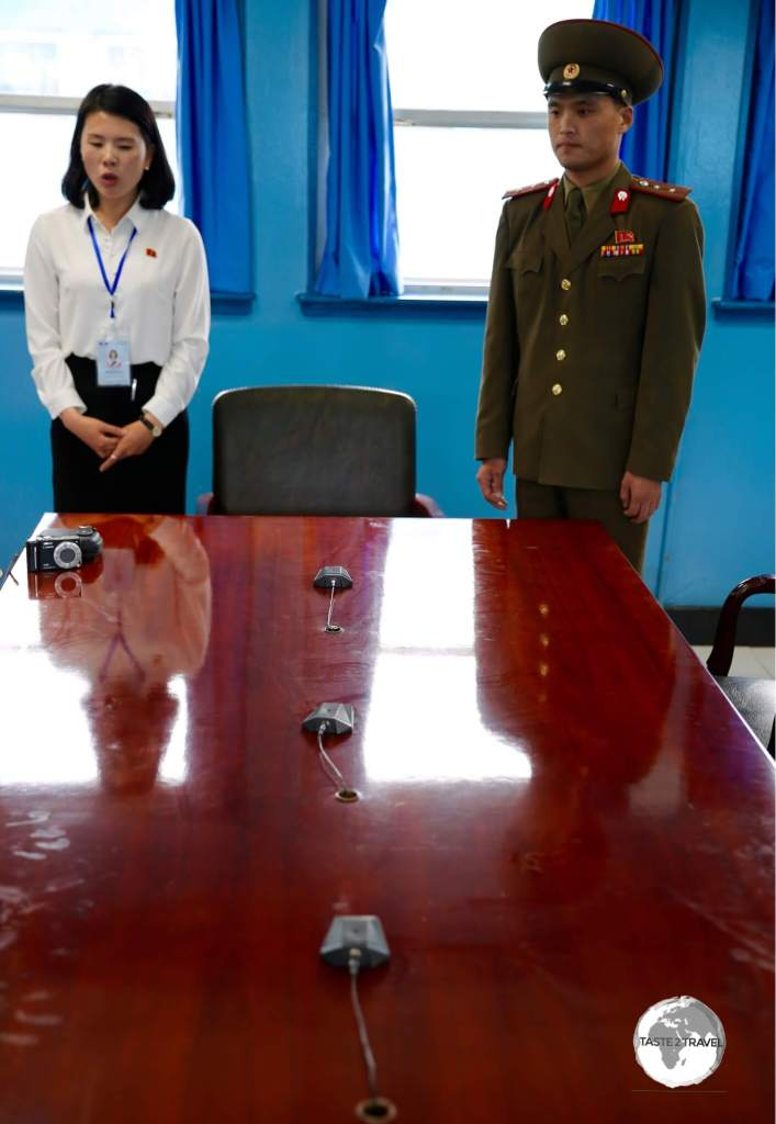 This table sits directly on the border between North And South Korea. The microphones mark the border. While in the room you are free to move from north to south.