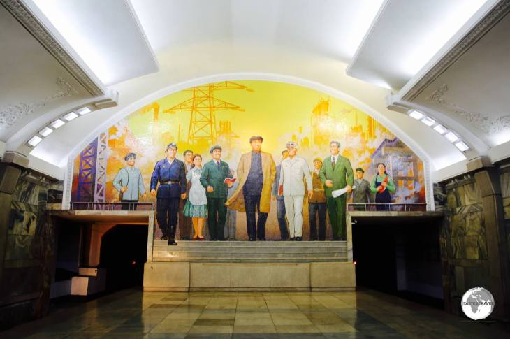 One of the key stations on the Pyongyang metro, Puhung station features a mural entitled <i>The Great Leader Kim Il-Sung Among Workers</i>.