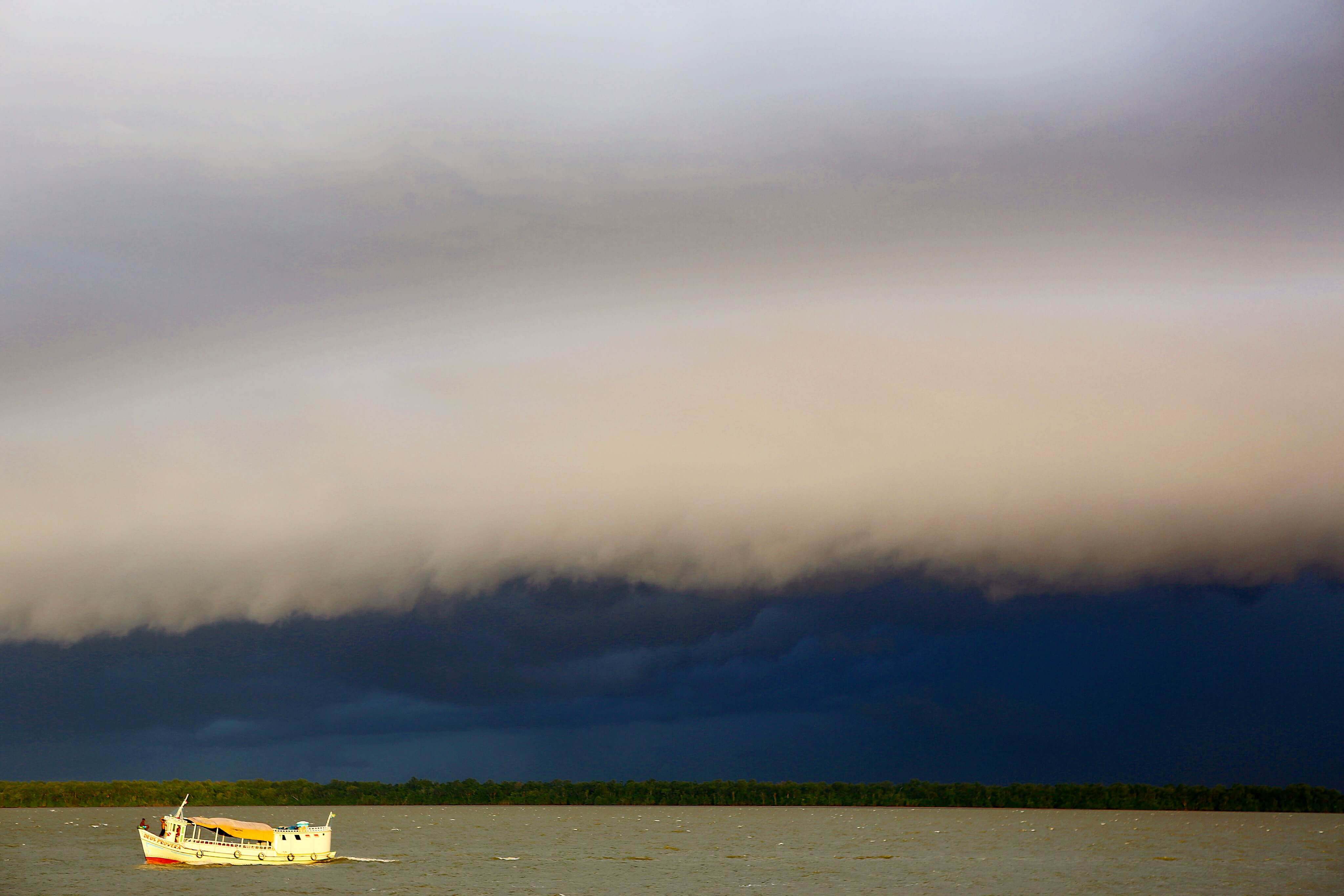 The daily storm clouds gather over the Amazon River near Belem.