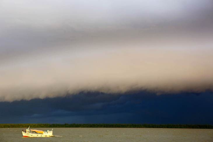 Daily storm clouds gather over the Amazon River near Belém.
