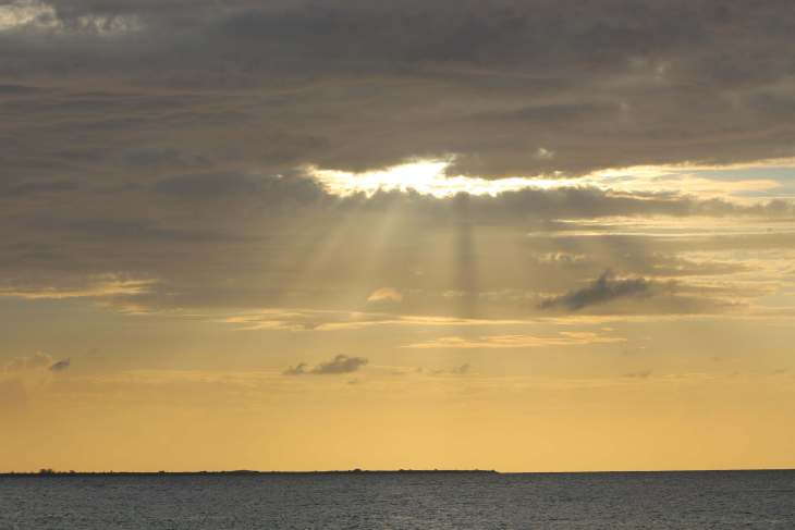 Sunset at West End Point, Cayman Brac – with Little Cayman in the distance.