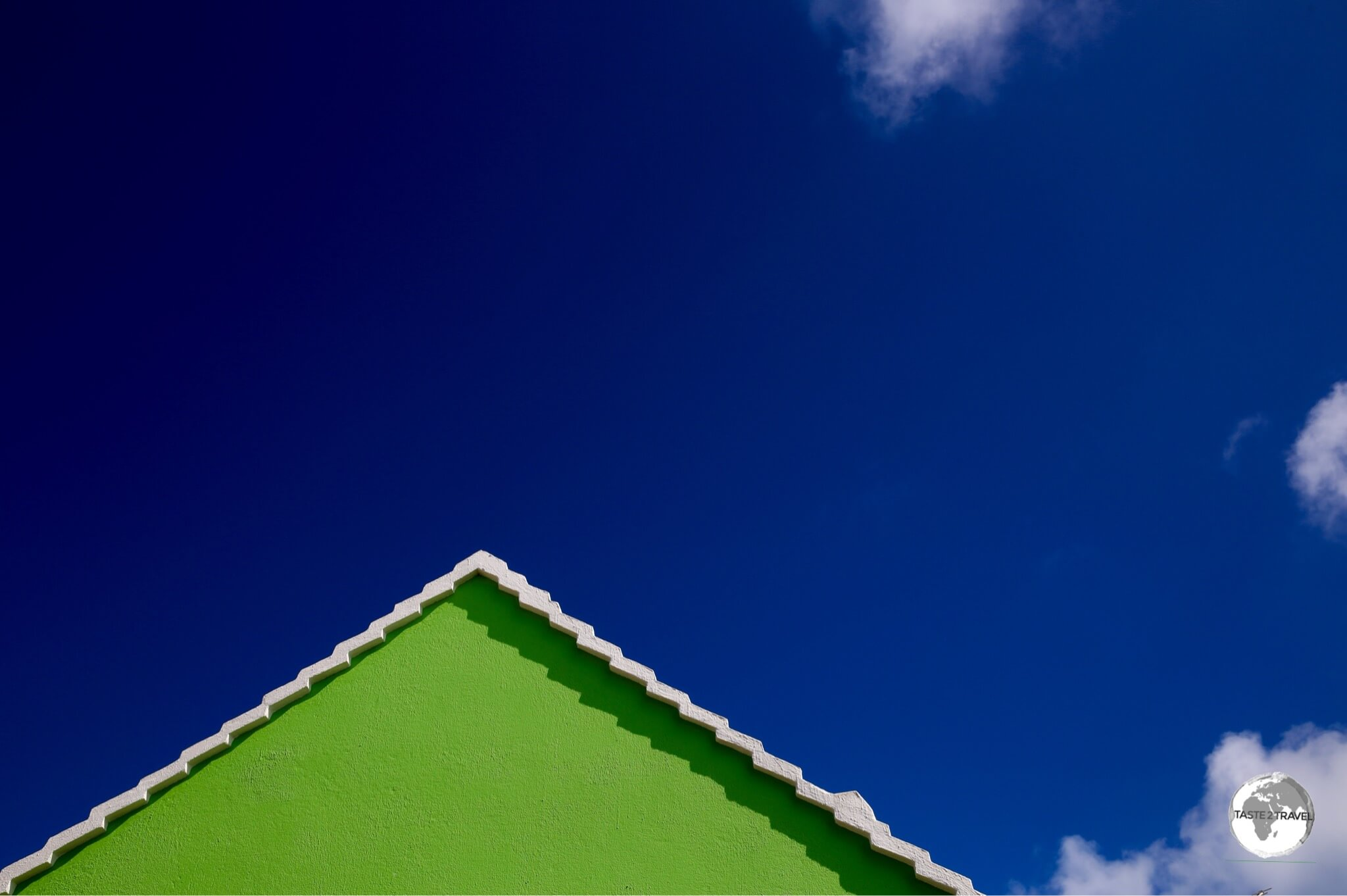 Green gable against a blue sky.