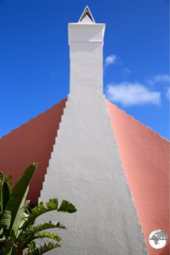 A pink gable and white chimney in St. Georges.