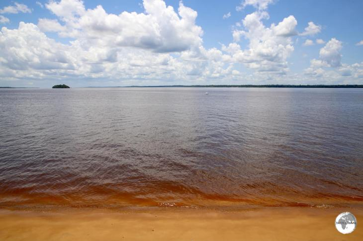 A red-earth beach on the Essequibo river in Bartica.