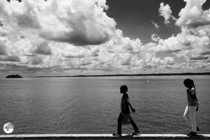 Girls walking along the Essequibo riverbank in Bartika, Guyana.