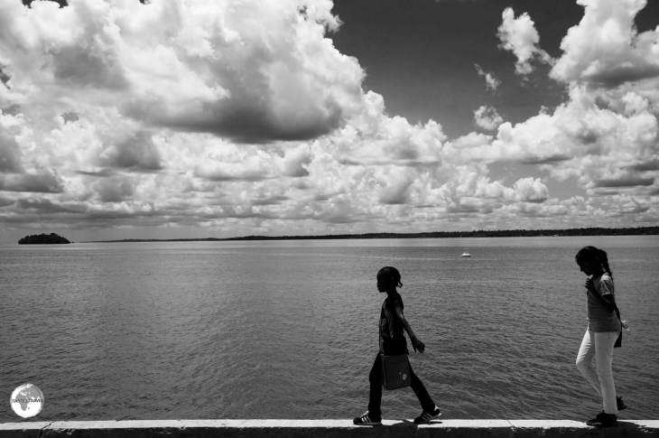 Girls walking along the bank of the Essequibo river in Bartica.