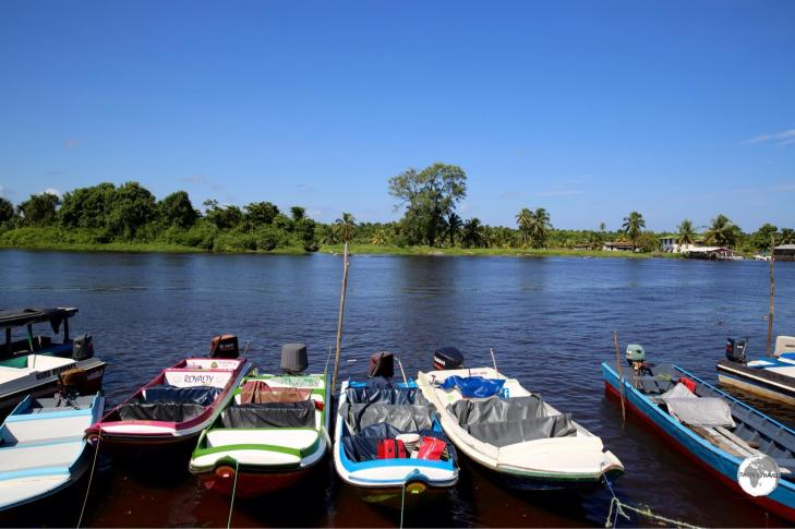 Passenger speedboats on the Pomeroon River in the riverside town of Charity, Guyana. In the 'Land of Many Waters', many communities are accessible only by boat.