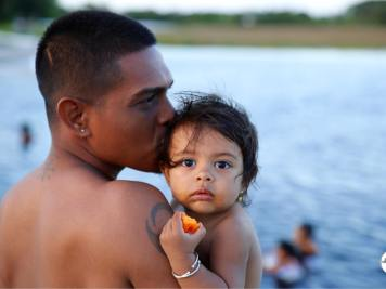 Essequibo Region Guyana Travel Guide: Father and daughter swimming at Lake Capoey
