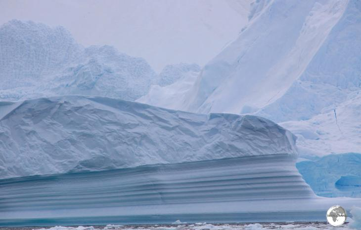 An iceberg in Neko harbour has been artfully carved by sea water.