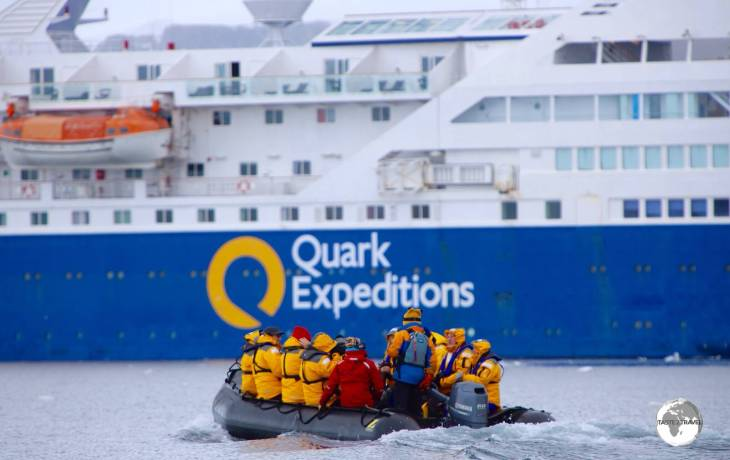 Returning to Quark Expeditions' <i>Ocean Diamond</i> after a Zodiac sea excursion on Crystal Sound.