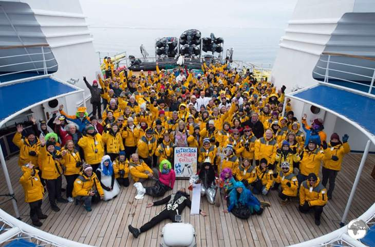 A group photo at the stern of the Ocean Diamond after crossing the Antarctic Circle.