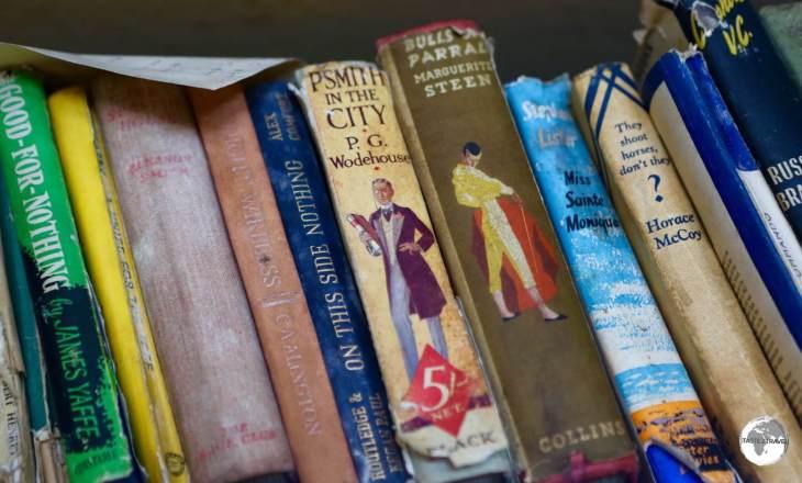 Books remain on the shelf at <i>Base W</i> on Detaille Island.