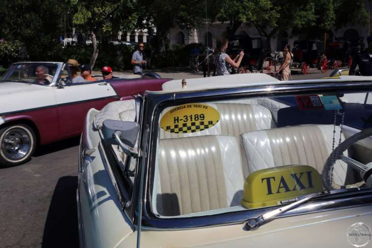 Beautifully maintained American classic car taxis at Parque Central in Havana old town.