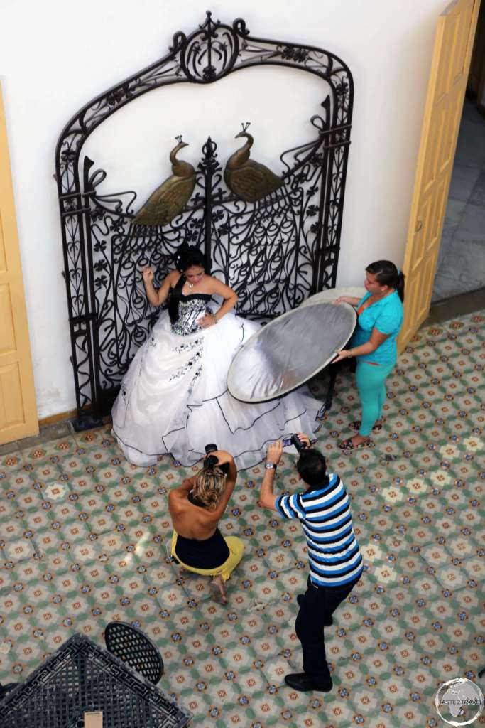 A bride being photographed inside the opulent Museo Provincial in Cienfuegos.
